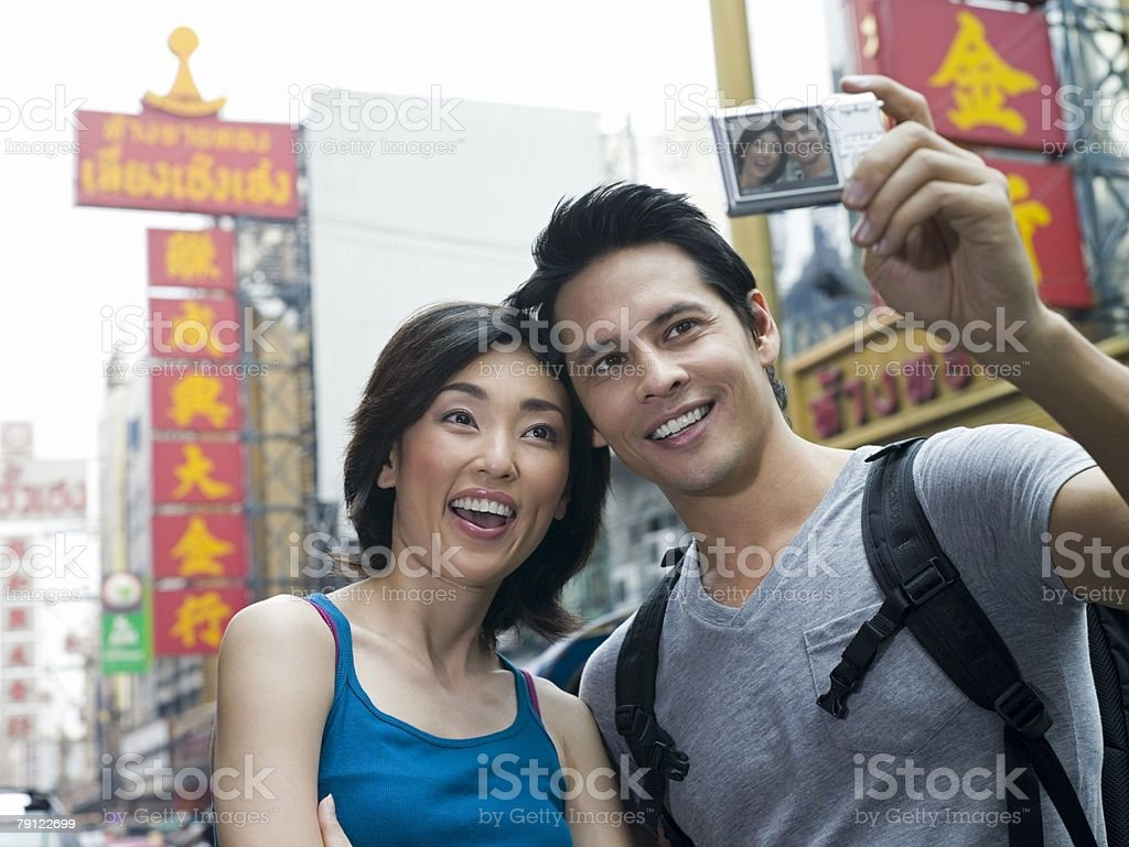 Couple taking a photograph royalty-free stock photo