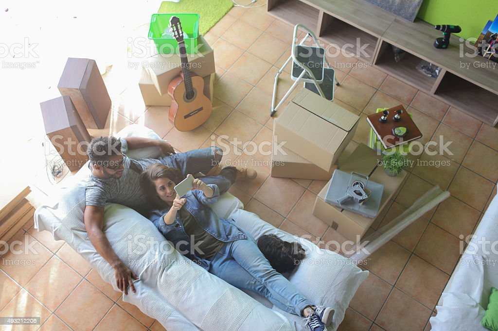 Couple taking a selfie in their new home stock photo