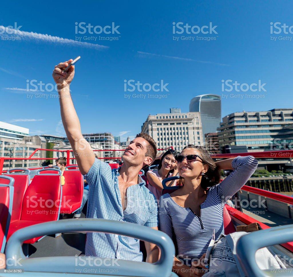 Couple taking a selfie on a tour bus stock photo