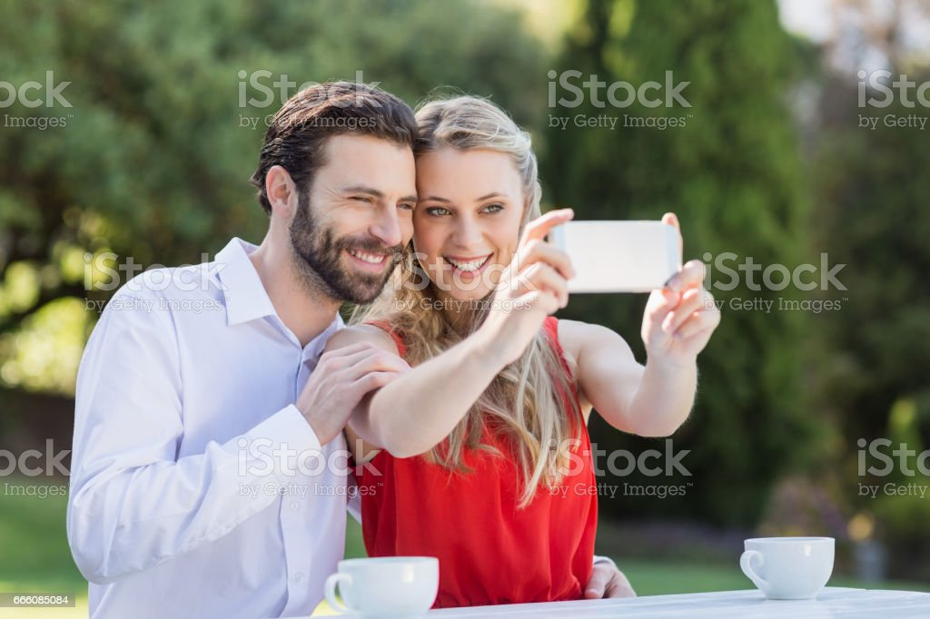 Couple taking a selfie on mobile phone stock photo