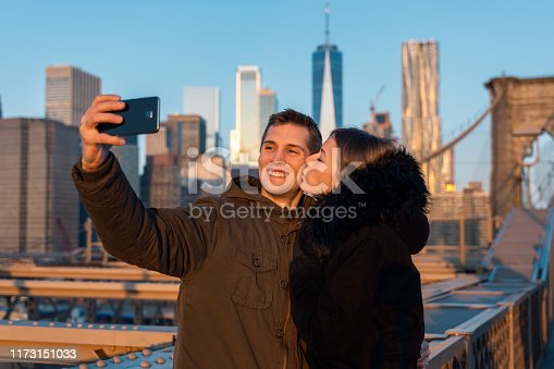 self portrait picture of a happy couple in the city of new york. skyscraper as background