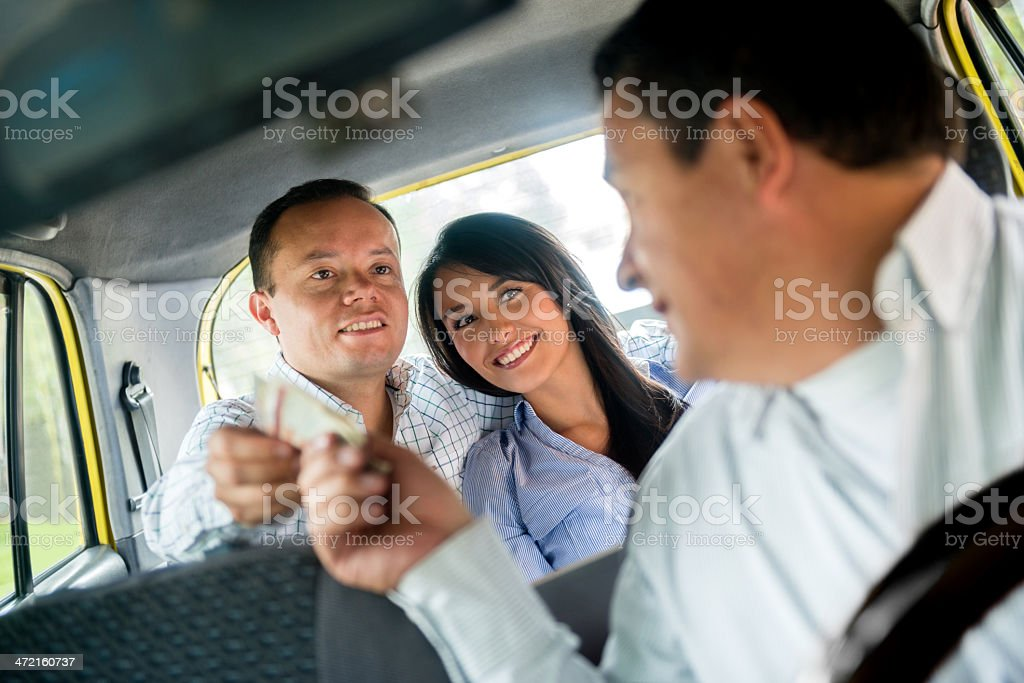Couple taking a taxi stock photo