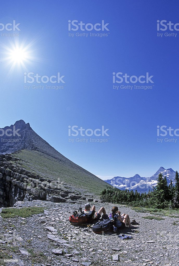 Couple taking break while backpacking. royalty-free stock photo