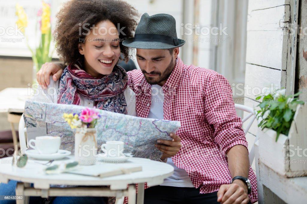 Couple taking map royalty-free stock photo