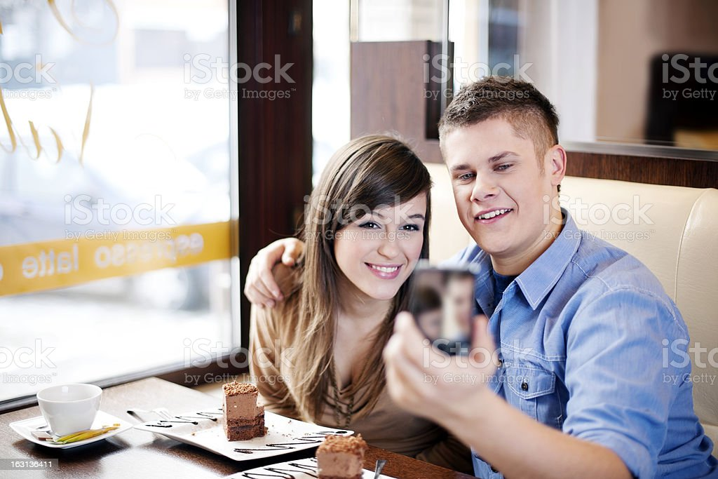 Couple taking picture in cafe royalty-free stock photo