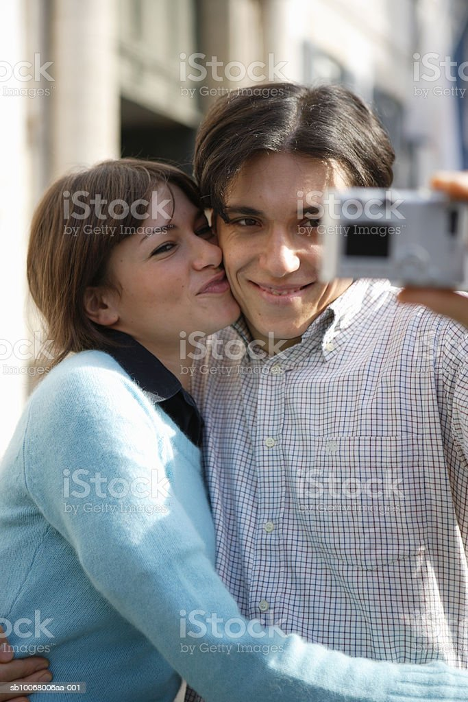 Couple taking picture on street royalty-free stock photo