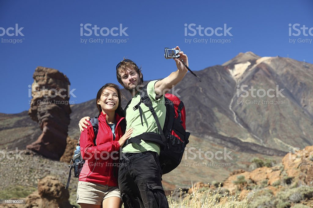 Couple taking picture royalty-free stock photo