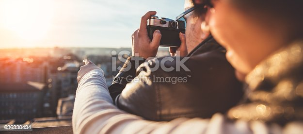 636330566istockphoto Couple taking pictures on the rooftop 636330434