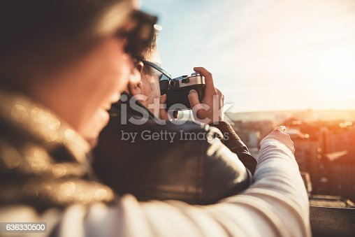 636330566istockphoto Couple taking pictures on the rooftop 636330500