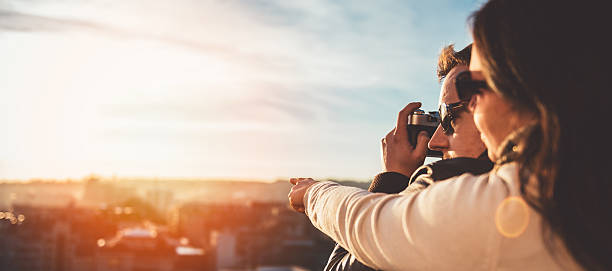 Couple taking pictures on the rooftop picture id636330566?b=1&k=6&m=636330566&s=612x612&w=0&h=7b8foyia4i7hv3vscf7clutbcasccxnv rykpmtzuqc=