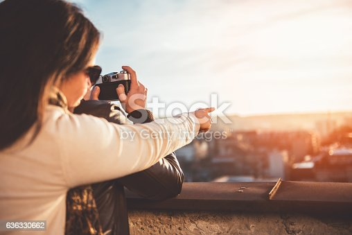636330566istockphoto Couple taking pictures on the rooftop 636330662