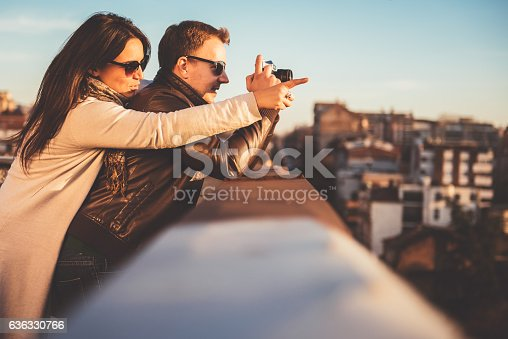 636330566istockphoto Couple taking pictures on the rooftop 636330766