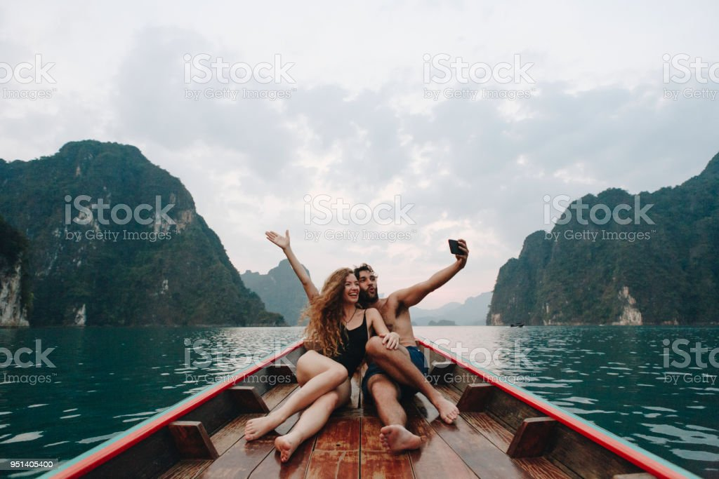 Couple taking selfie on a longtail boat stock photo