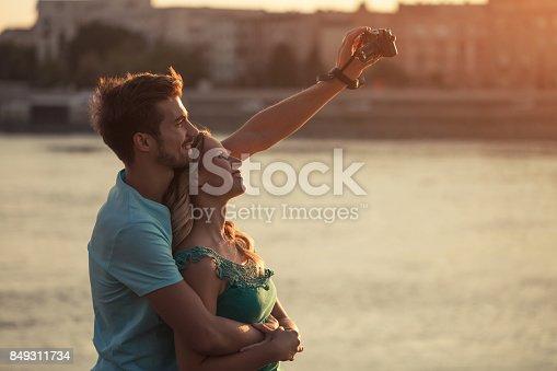 636330566istockphoto Couple taking selfie 849311734