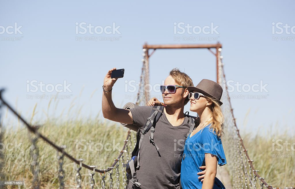 Couple taking selfportraits royalty-free stock photo