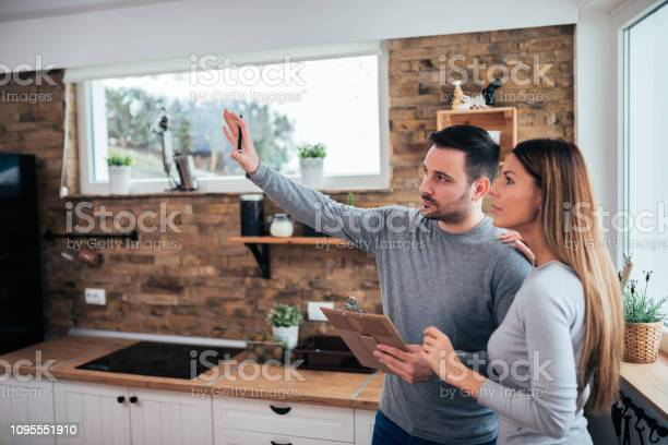 Couple talking about home renovation standing in the kitchen and picture id1095551910?b=1&k=6&m=1095551910&s=612x612&h=exd7wzfi vcgwr8gnjeul8j5agbgb0rqb5lb20jx1cu=
