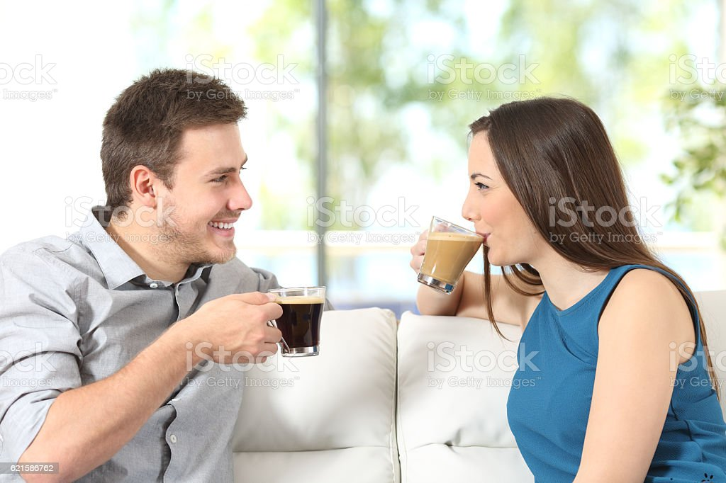 Couple talking and drinking coffee stock photo