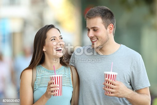 930265372 istock photo Couple talking and holding takeaway refreshments 829505452
