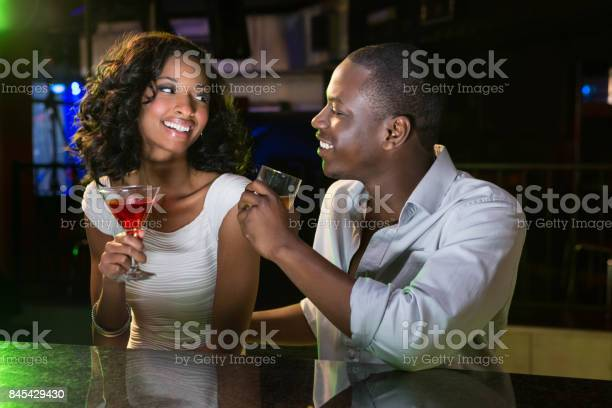 Couple talking and smiling while having drinks at bar counter picture id845429430?b=1&k=6&m=845429430&s=612x612&h=h3efqy rzudpepe8v81vhga7znyxgzrjgqtk pu4kag=