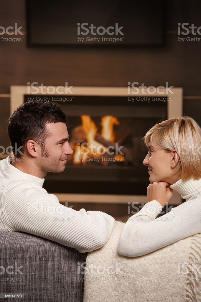Couple talking in a cozy living room royalty-free stock photo