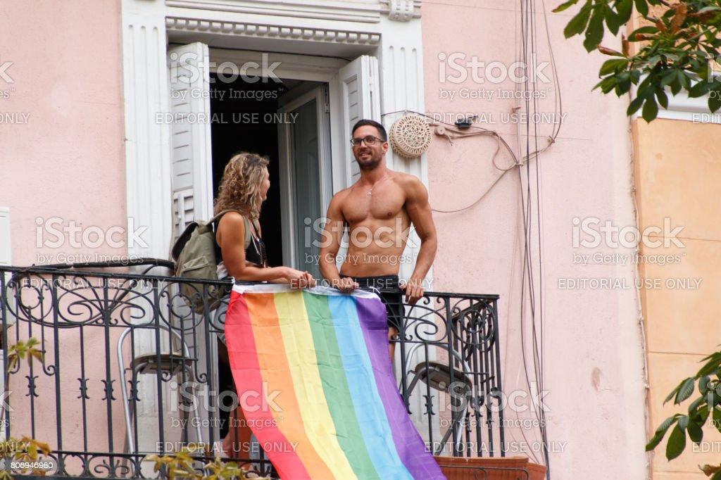 Couple talking on a balcony stock photo