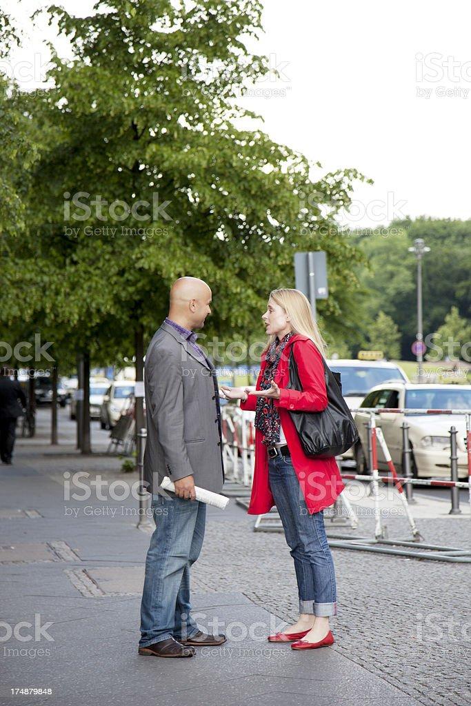 Couple talking on the sidewalk royalty-free stock photo
