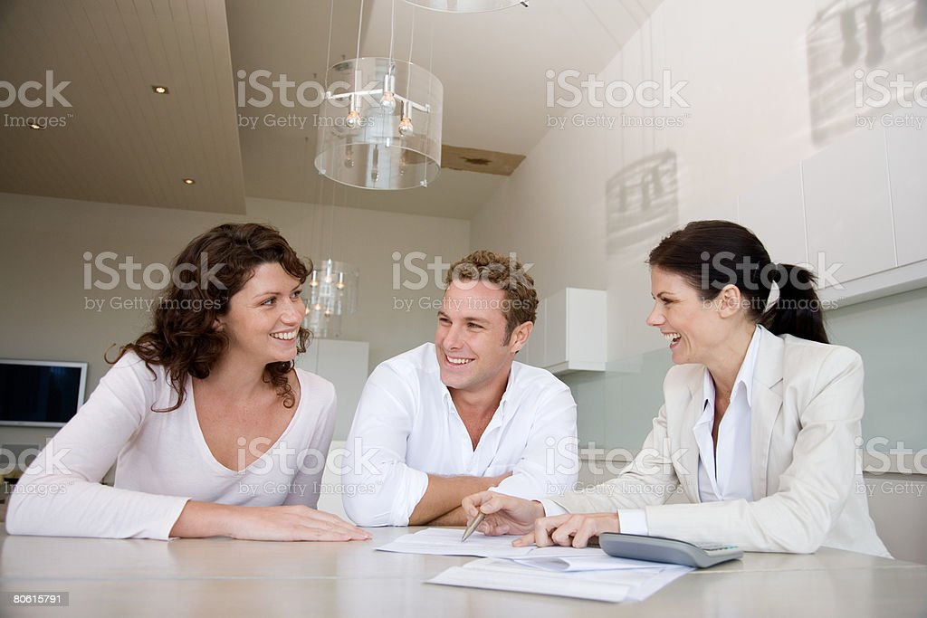 A couple talking to a financial advisor royalty-free 스톡 사진