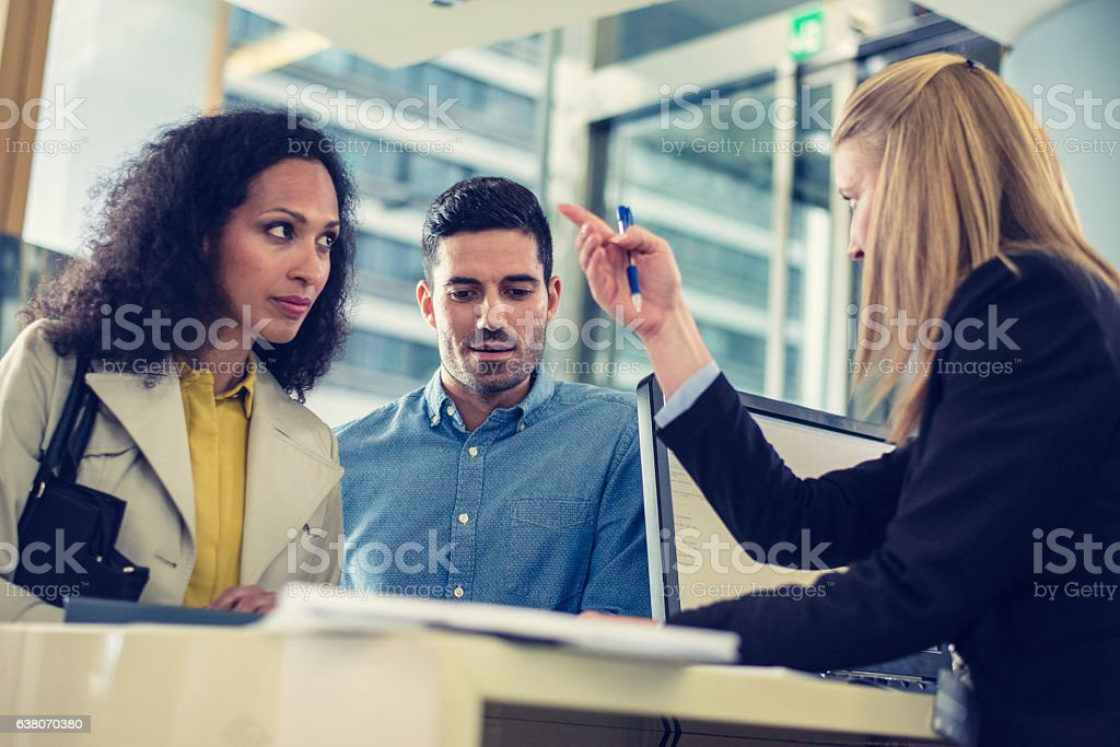 Couple talking to bank employee about loan - Photo