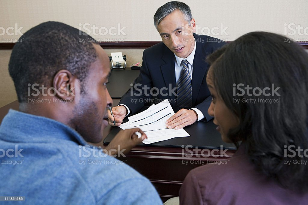 Couple talking to bank manager stock photo