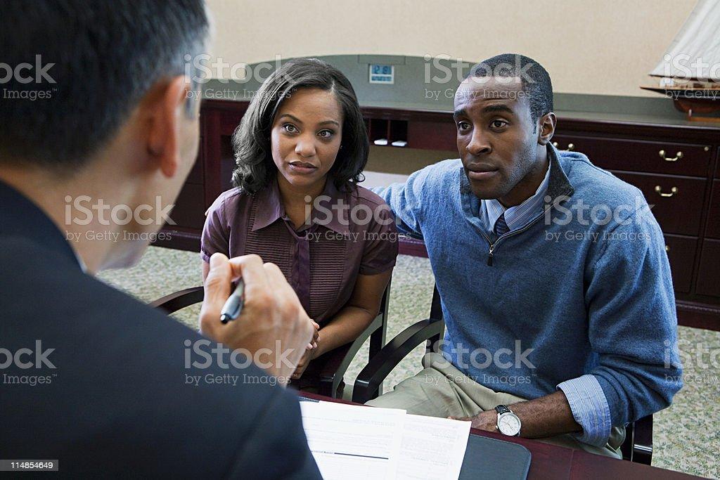 Couple talking to bank manager stok fotoğrafı