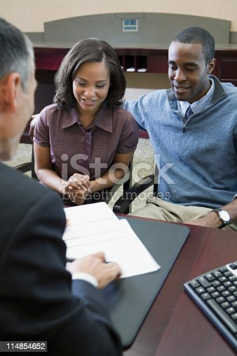 istock Couple talking to bank manager 114854652