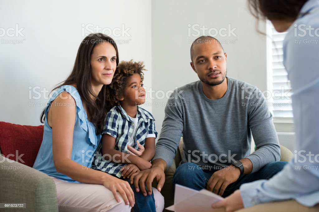 Couple talking to family counselor stock photo