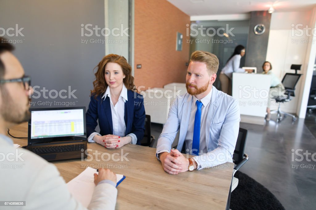 Couple talking to loan officer royalty-free stock photo