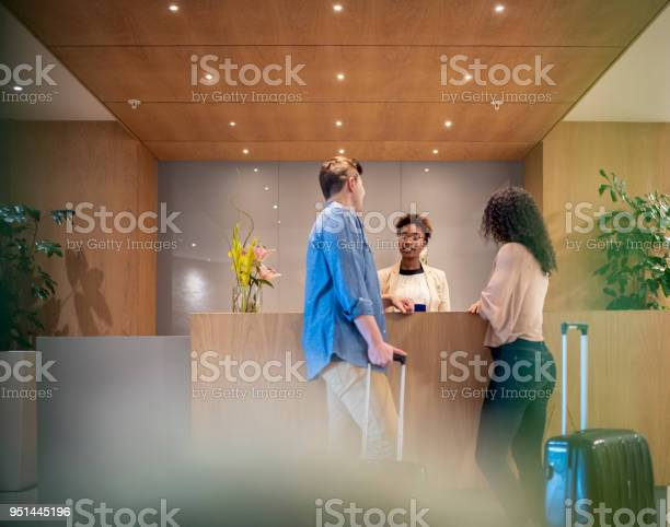 Couple talking to receptionist at hotel lobby picture id951445196?b=1&k=6&m=951445196&s=612x612&h=ruo8piq0t3phqkayblcakoldgqb2z3bxtsurfkrwav0=