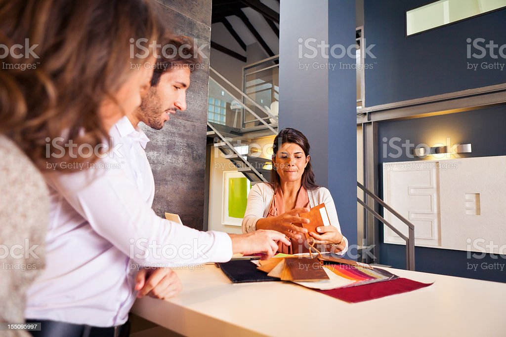 couple talking to their interior designer stock photo