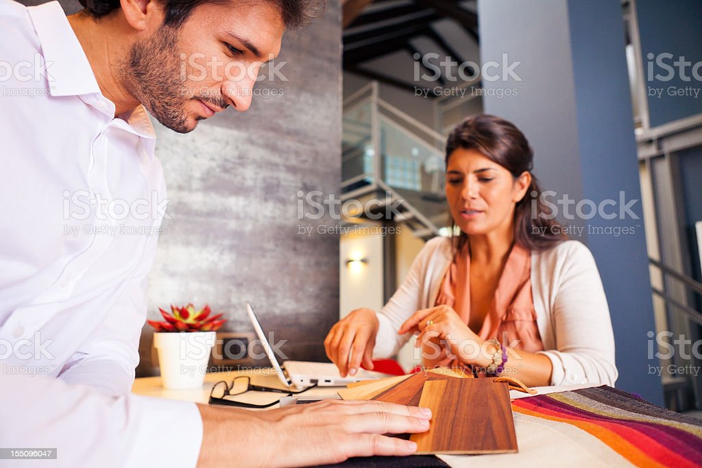 couple talking to their interior designer royalty-free stock photo