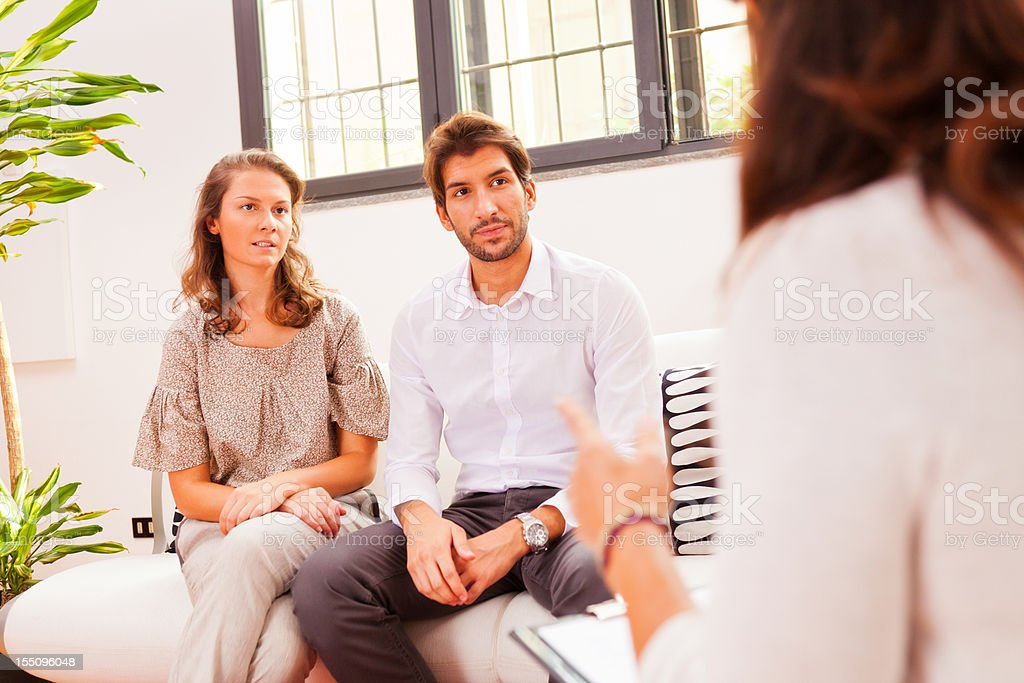 couple talking to their psychologist stock photo