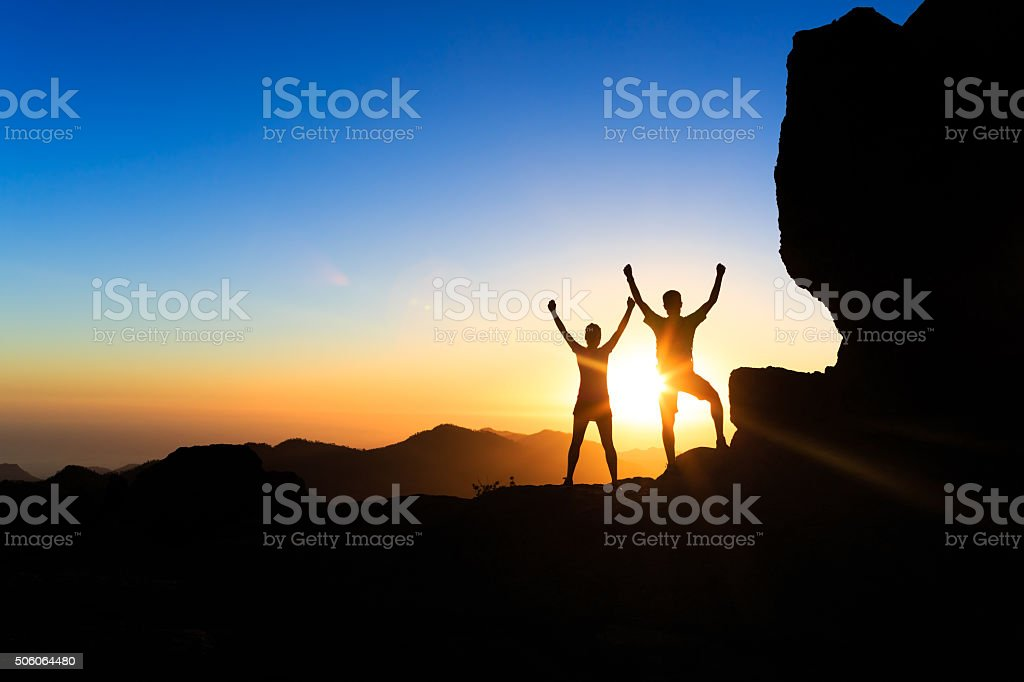 Couple teamwork people, inspiring success in mountains stock photo