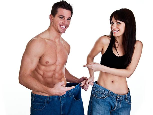 paar, das gewicht zu verlieren - damen sporthose übergröße stock-fotos und bilder