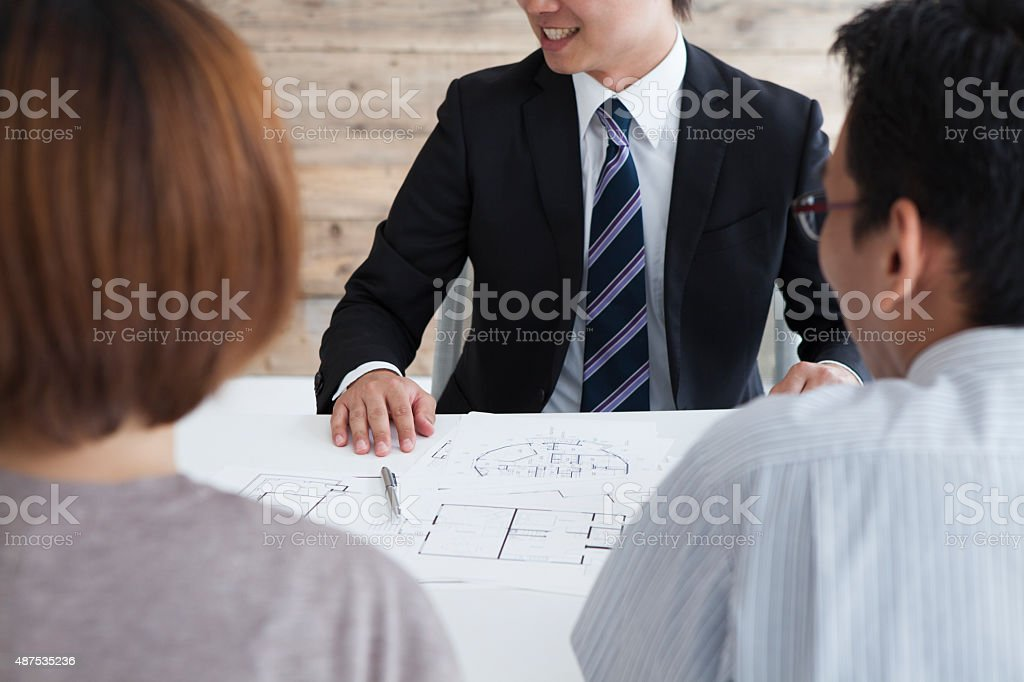 Couple to chat with real estate agency stock photo
