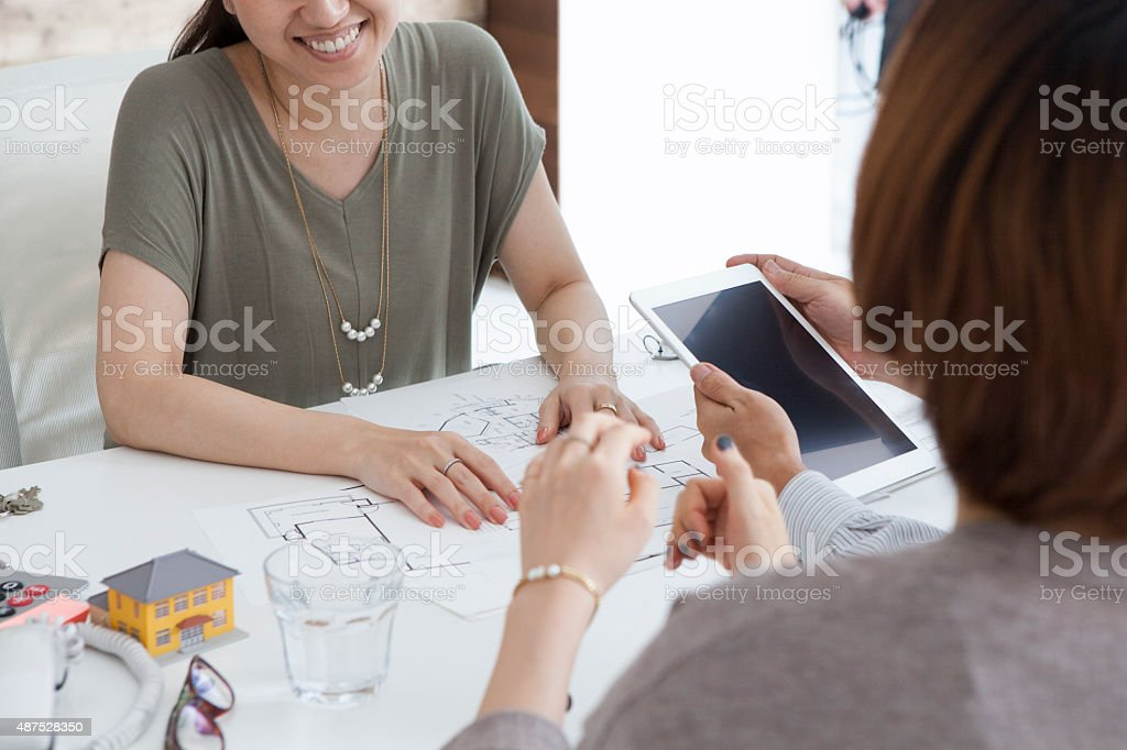 Couple to confirm the design view of the house stock photo