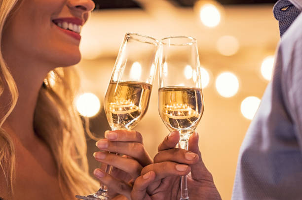 couple toasting campagne flutes - couple lap stock photos and pictures