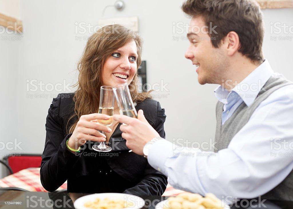 Couple toasting during an italian aperitif royalty-free stock photo