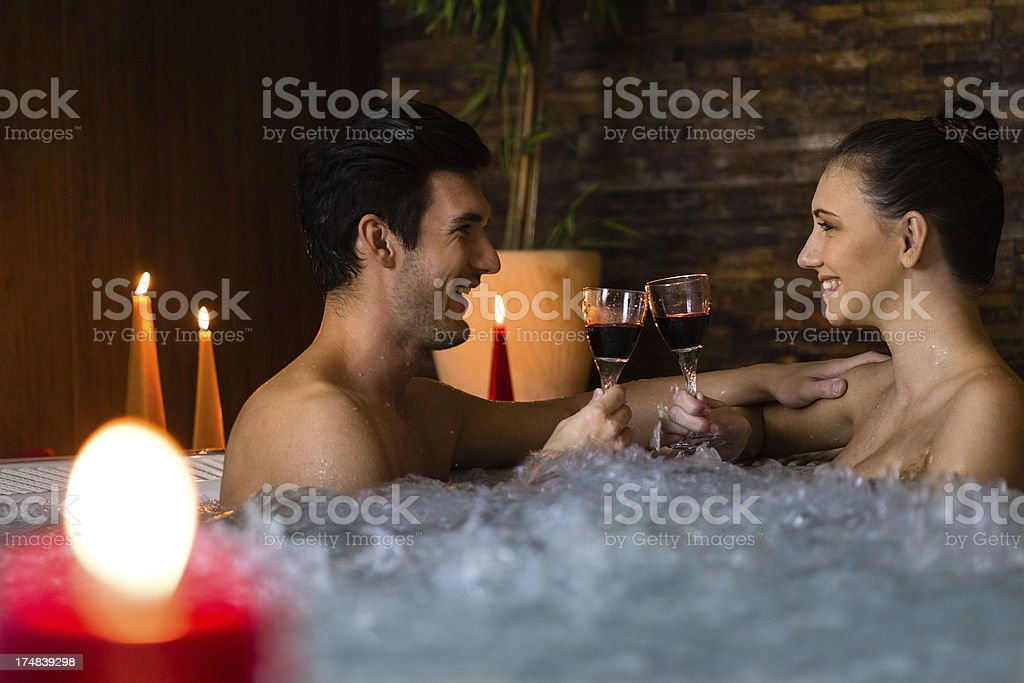 Couple toasting in jacuzzi royalty-free stock photo