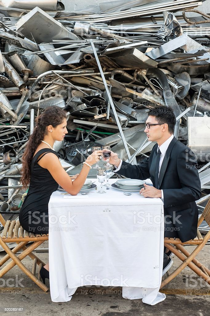 Couple Toasting in Landfill stock photo