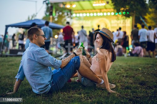 istock Couple toasting on a music festival 1159645377