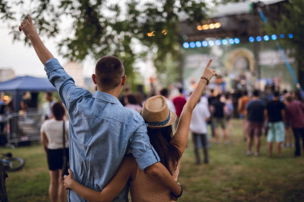 Couple toasting on a music festival stock photo