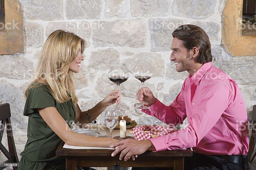 A couple toasting foto de stock royalty-free