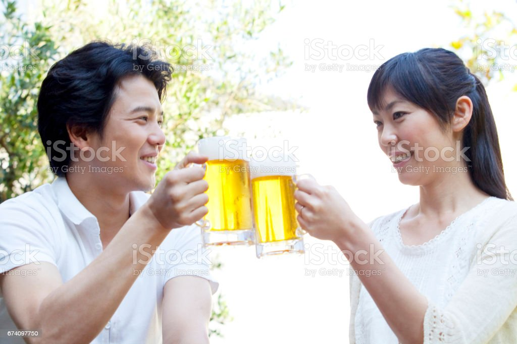 Couple toasting with beer royalty-free stock photo