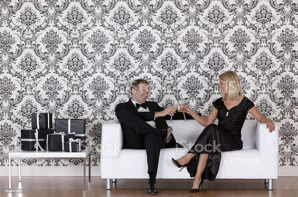 Couple toasting with champagne flutes royalty-free stock photo